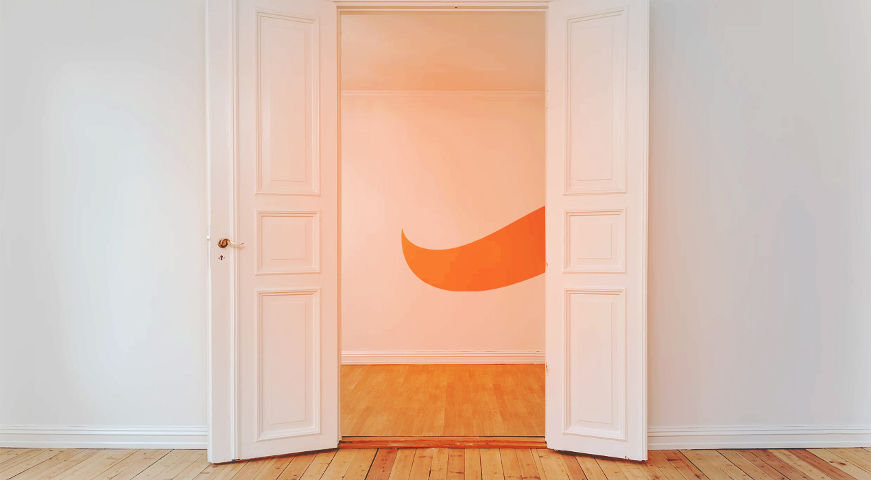 Wall with two white open doors, orange Squirrel tail on the wall
