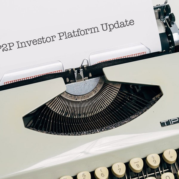 Typewriter, white paper that reads P2P Investor Platform Update