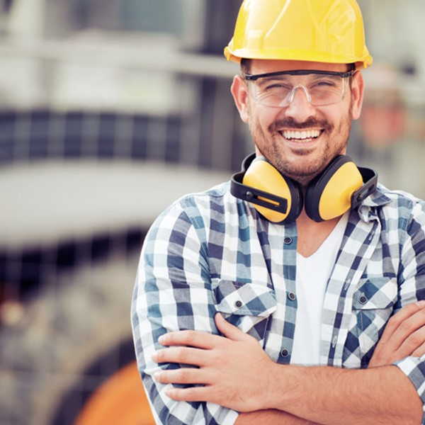 Man in construction gear smiling at camera