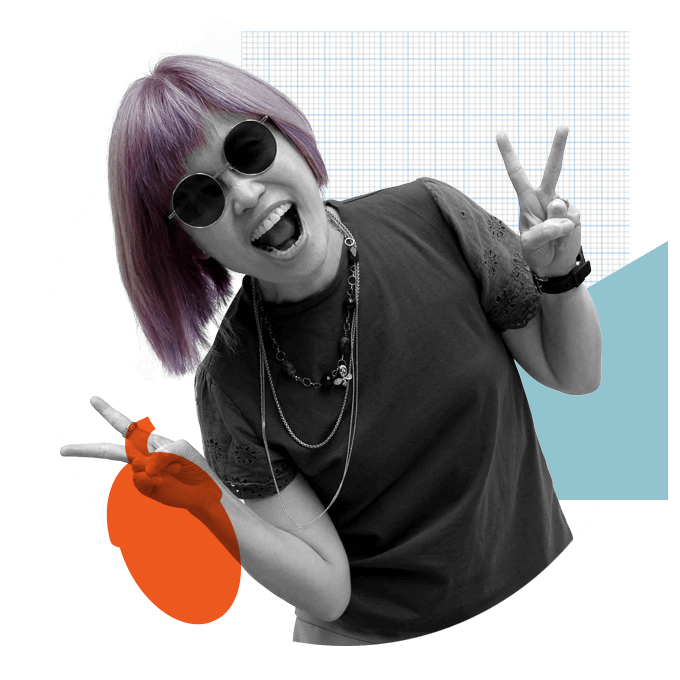 Woman with purple hair smiling, doing peace sign with hands