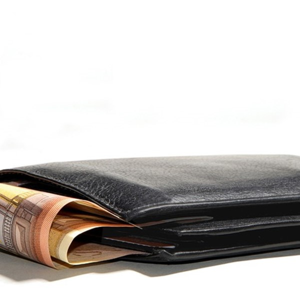 Black wallet with money popping out