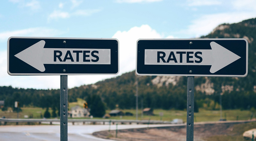 Road signs both saying Rates