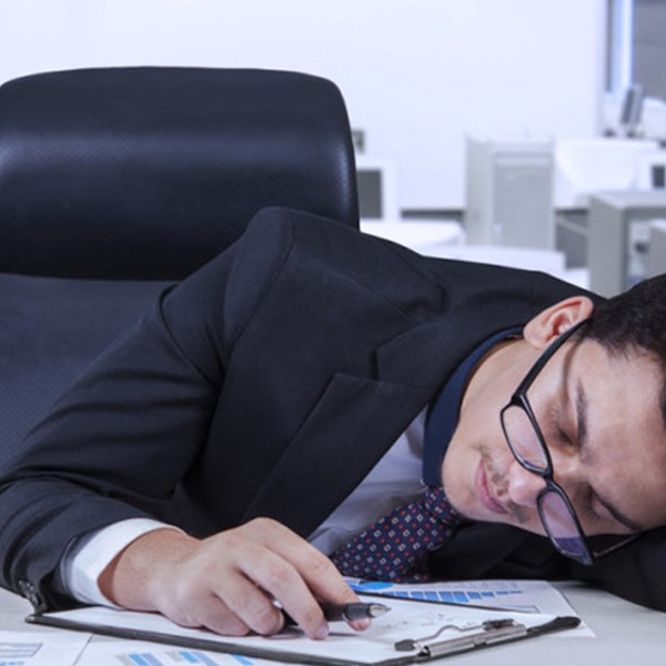 Business man sleeping on his desk