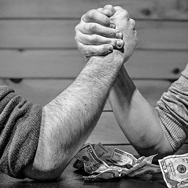 Two men arm-wrestling