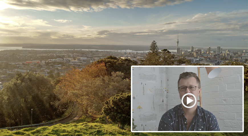Auckland city and an image of JB and a video play button