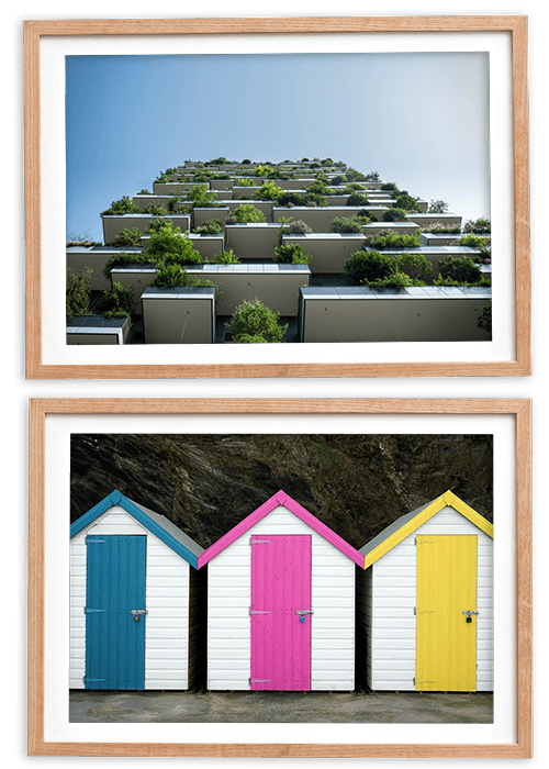 Apartment building and colourful beach huts