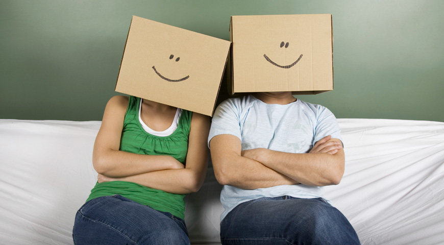 Young couple with boxes on heads