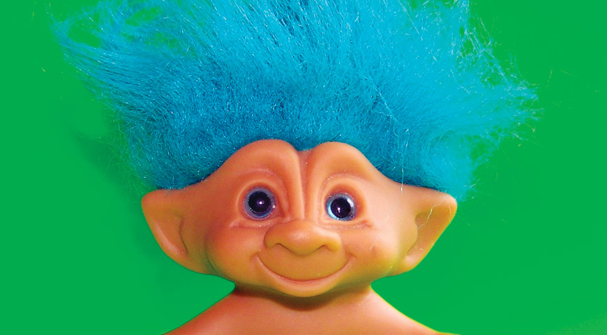 Troll with blue hair against green background