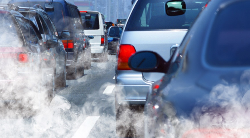 Cars in traffic letting off emission