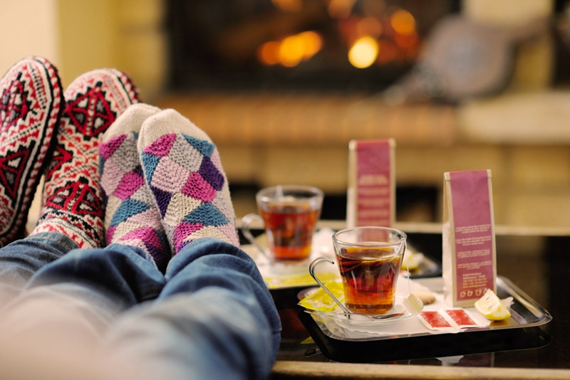 Comfy socks, snuggling in front of a fire with tea