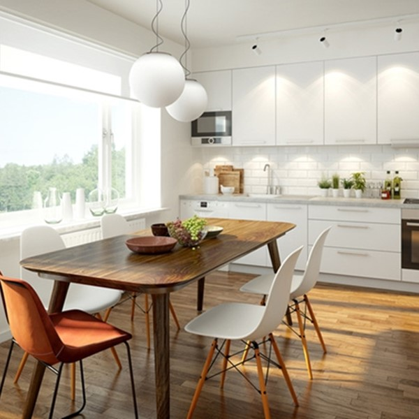 Sunny kitchen with wooden table and chairs