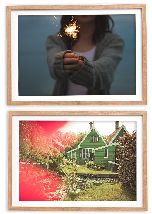 Woman holding up a sparkler and a backyard of a small house
