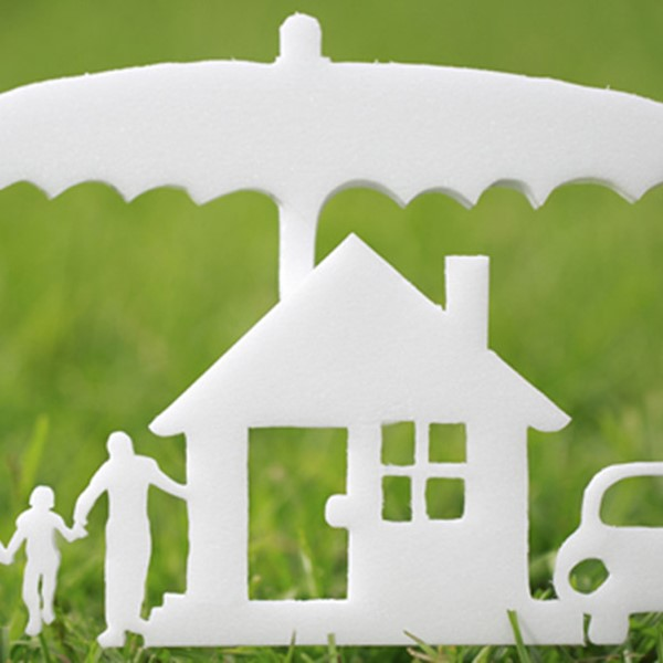 Cutout of family, house & car under umbrella