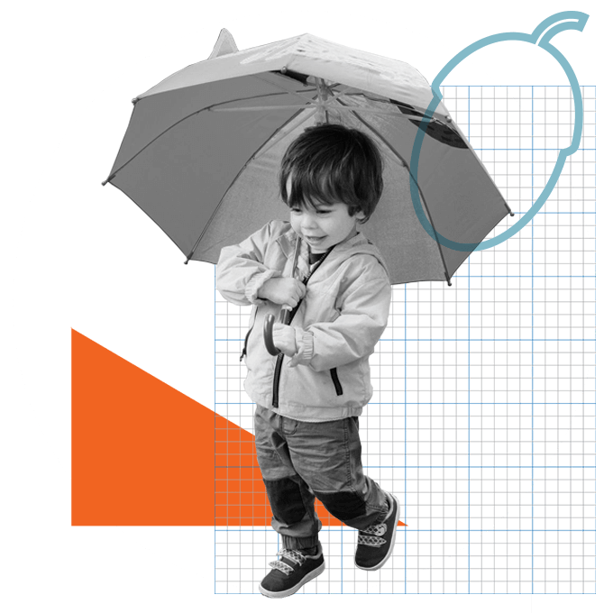 Young boy holding umbrella