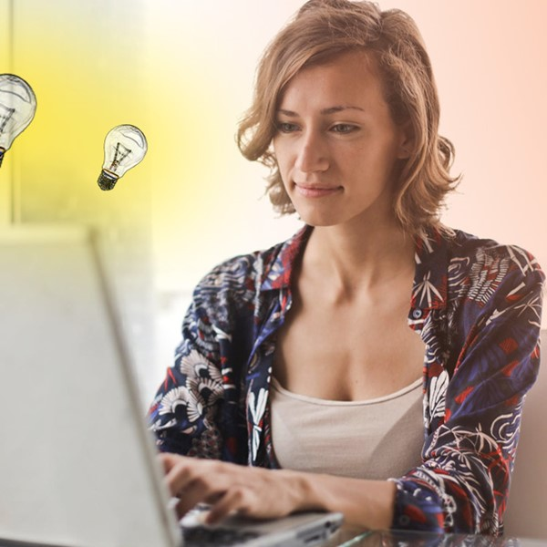 Woman seated at home looking at mortgage hack on laptop