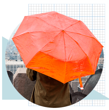 Umbrella covering person in a coat, on a rainy day