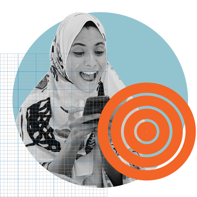 Happy woman wearing hijab looking at phone