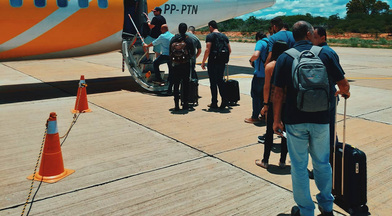 People lining up to board an airplane