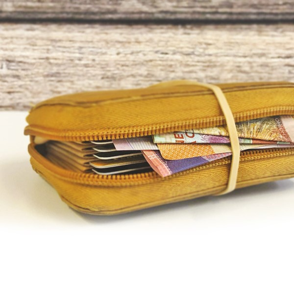 Rubber band around cash inside a wallet