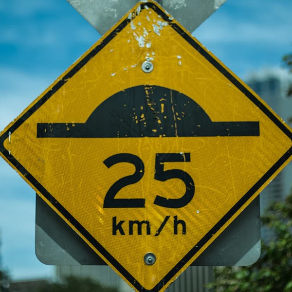 Speed bump sign, 25km/h ahead